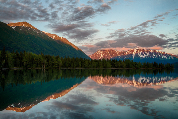Alpenglow on the Chugach Mountains reflected in Kenai Lake